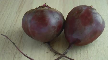 Two whole red beetroots. Food background. Close up rotation