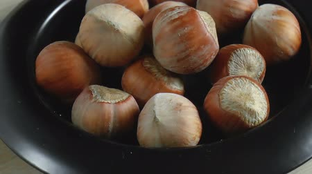 avelã : Hazelnuts nuts in bowl. Food background. Close up rotation Stock Footage