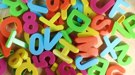 tanımlayıcı : Plastic colored letters and numbers. Alphabet background. Top view