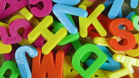 gramotnost : Plastic colored letters and numbers. Alphabet background. Top view