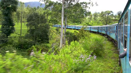 Passenger view of a classic train of Sri Lanka, on a trip in rural countrysides from Ella to Nuwara Elia. A must every visitor do.