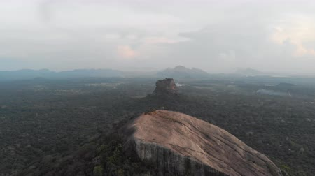 Aerial view flying backwards of Pidurangala and Sigiriya Rock, a must to see in Sri Lanka. Shot in 4k. Stock Footage