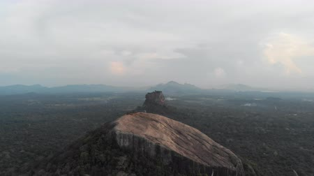 Aerial cinematic tilt up flight of Pidurangala and Sigiriya Rock at sunset. One of the most tourist places of SRI LANKA. Shot in 4k