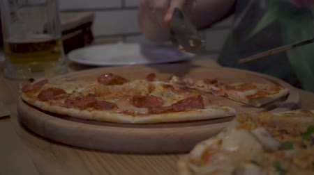 group of people eat pizza at a cafe. close-up children teens eating fast food in cafe HD