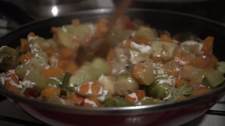 peas : vegetable stew, onions, carrot and tomato fried in vegetable oil in the pan. Process stewing vegetable in restaurant kitchen. Close-up, 4k, Stock Footage