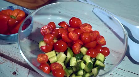 come : slow motion, fresh vegetables falling into the bowl salad tomato, cucumber, olives drops on kitchen healthy, close up, macro, HD