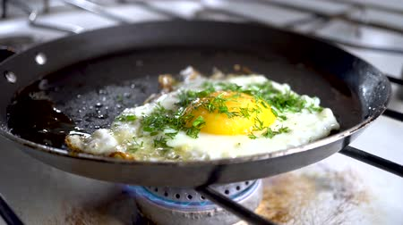 omlet : 4k. Close-up of breaking and dropping pan for breakfast.