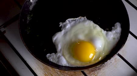 scrambled eggs : Frying pan for breakfast.slow motion