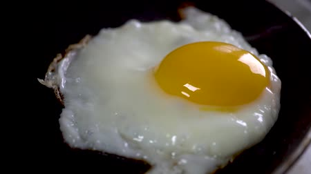 cholesterol : Frying pan for breakfast.slow motion