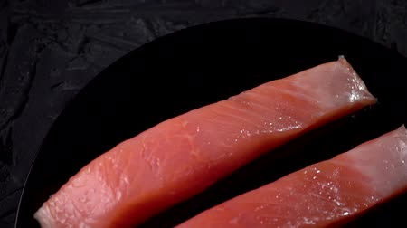 alaszka : Raw salmon fillet on a slate board. Raw salmon red fish. HD, Slow motion, Cooking salmon, seafood. Healthy food concept. Stock mozgókép