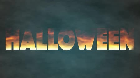 The fire inscription with word Halloween burn. The concept horror day. Loop opening animation introduction with hot burning text on realistic fire flames on smoke background. Vídeos