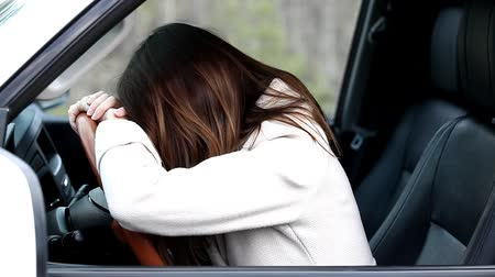 Crying woman driver in a car