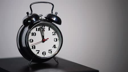 Alarm clock on a table, white background