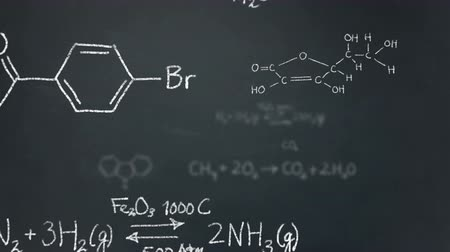 формула : Chemistry formulas and structures floating on a chalkboard
