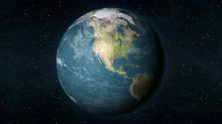 dönen : Planet Earth, seen from space, zooming in and centering on the North American continent.
