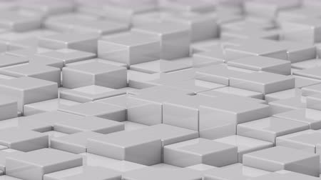 acalmar : White cubes moving up and down in a random pattern. 3D animated motion background loop. Vídeos