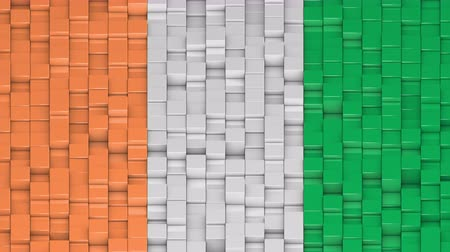 vertical stripes : Ivorian flag made of cubes moving up and down in a random pattern. 3D animated motion background loop.