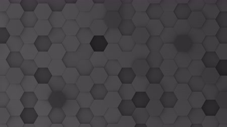 bobbing : Black hexagons moving up and down in a random pattern. 3D animated motion background loop. Top down isometric view.