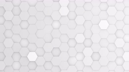 bobbing : White hexagons moving up and down in a random pattern. 3D animated motion background loop. Top down isometric view. Stock Footage