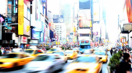 lapse : Abstract, high-contrast time lapse of Times Square in the daytime, with blurringobscuring of signs and people.