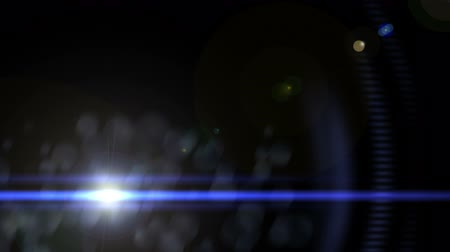 título : A looping flickering lens flare with a blue streak over a black background Stock Footage