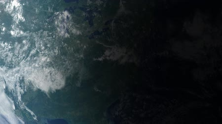 yörünge : Satellite view of North America as daylight spreads across the globe. Earth clouds and land maps courtesy of NASA: http:visibleearth.nasa.gov Stok Video