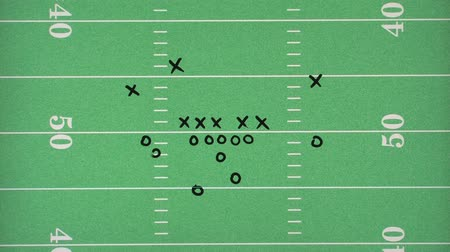 oklar : Football play being drawn over a graphic of a football field (also available over white background) Stok Video