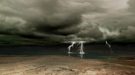 mroczne : Ominous clouds and lightning over a desert plain (composited with the Dead Sea)