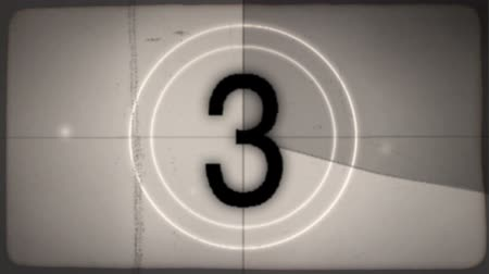 lider : 2 versions of an old-fashioned film countdown leader (color and desaturated sepia) with crackling audio.