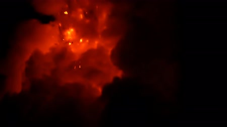 Close up of lava exploding out from a lava tube in Hawaii at night Dostupné videozáznamy
