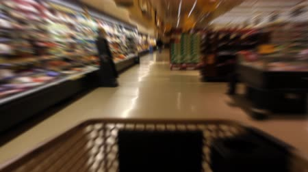 aisles : Time Lapse of shopping cart moving through the aisles of a supermarket with motion blur