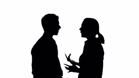 taciz : Isolated silhouette of a couple arguing