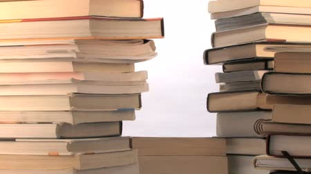 ödev : Books piling up over a white background