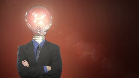 innováció : A man in a suit with a light bulb in place of a head steps into frame, taps the bulb, and a light flickers on. Centered version also available.