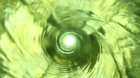dönen : Abstract water tornado, shot from the top of the vortex, looking down, with green light shining through