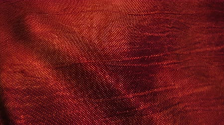 hedvábí : Red silk fabric blowing in the wind. Seamless loop