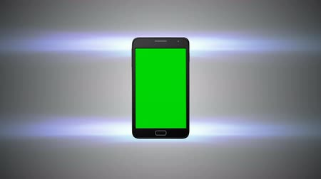 eszköz : Animation of a chroma key screen of a smartphone against grey background with flares