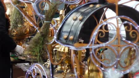 escalera : many brilliant metal samovars at the celebration of the city holiday.