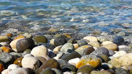 escalera : Pebble and pure sea water at sunny summer day, close up view