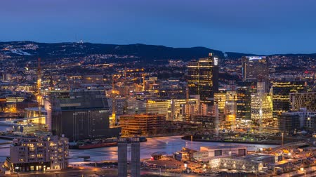 kod kreskowy : Oslo Norway time lapse 4K, aerial view city skyline day to night sunset timelapse at business district and Barcode Project