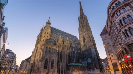 st stephen : Vienna Austria time lapse 4K, city skyline night to day timelapse at St. Stephens Cathedral