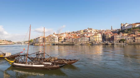 vila : Porto Portugal time lapse 4K, city skyline timelapse at Porto Ribeira and Douro River with Rabelo wine boat