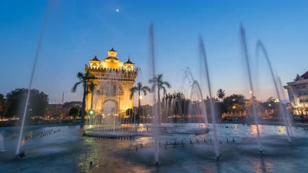 vientiane : Vientiane Laos time lapse 4K, city skyline day to night sunset timelapse at Patuxai (Patuxay) Stock Footage