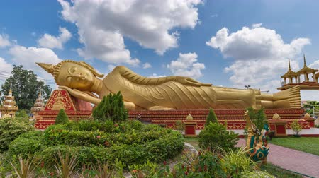 luang : Vientiane Laos time lapse 4K, timelapse at Reclining Buddha statue in Wat Pha That Luang