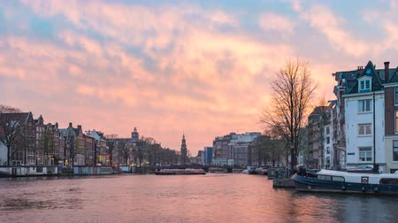 Amsterdam Netherlands time lapse 4K, city skyline sunset timelapse at canal waterfront