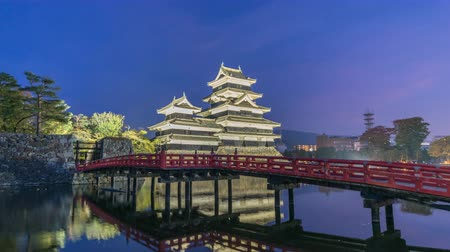 Matsumoto Nagano Japan time lapse 4K, city skyline day to night timelapse at Matsumoto Castle Stok Video