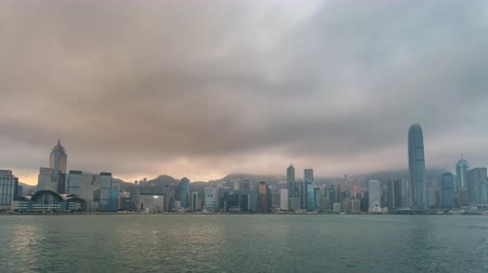 Hong Kong time lapse 4K, city skyline night to day timelapse at Victoria Bay Hongkong