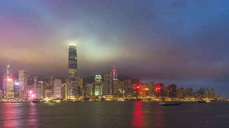 Hong Kong time lapse 4K, city skyline day to night timelapse at Victoria Bay Hongkong