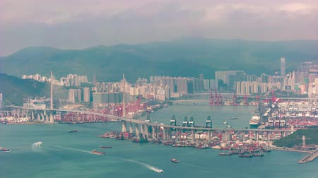 Hong Kong time lapse 4K, city skyline timelapse at Hongkong harbor and Tsing Ma bridge
