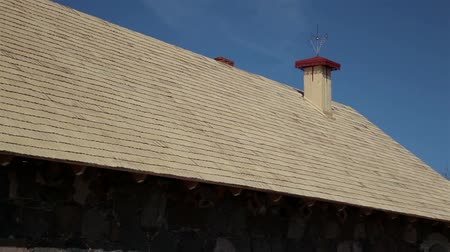 housing problems : Whole side view of the wooden roof and stone walls that is newly built and is sturdily made. Cedar wooden shingle on the roof carpentry roofing roofworking build economy industry. Stock Footage